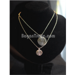 Handmade silver necklace with coil pendant